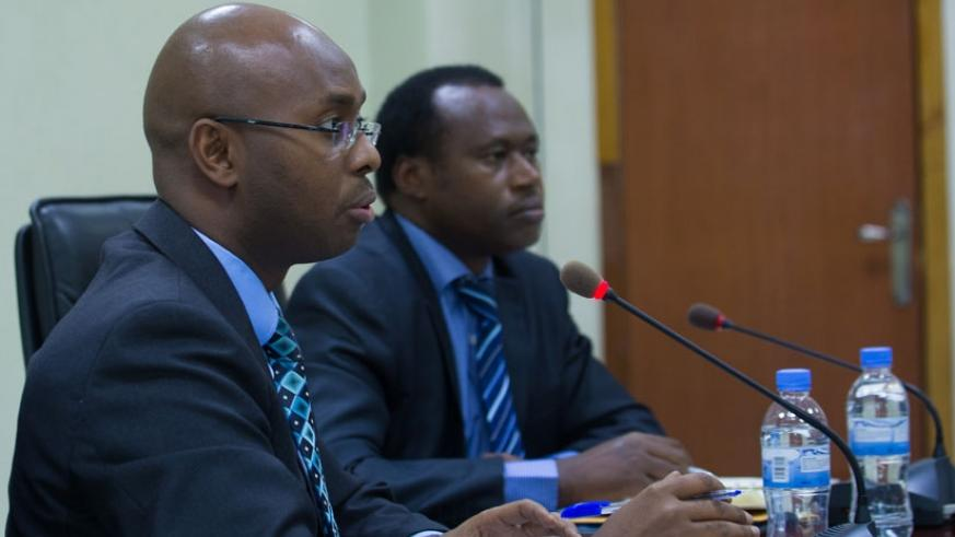 The Director-General of the National Institute of Statistics of Rwanda, Yusuf Murangwa (L), explains results of the gross domestic product for the second quarter as Dr Uzziel Ndagi....