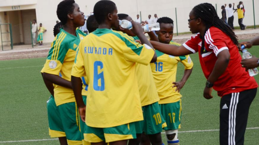 Coach Grace Nyinawumuntu talks to her players during a past match. / File