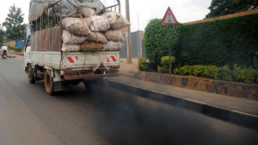 Fumes belch from a vehicle on Kanombe-Remera road. High-sulphur fuels can permanently damage emission-reducing technologies in cars, experts say. (File)