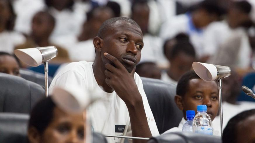 A participant follow proceedings at Parliament yesterday. (Nadege Imbabazi)