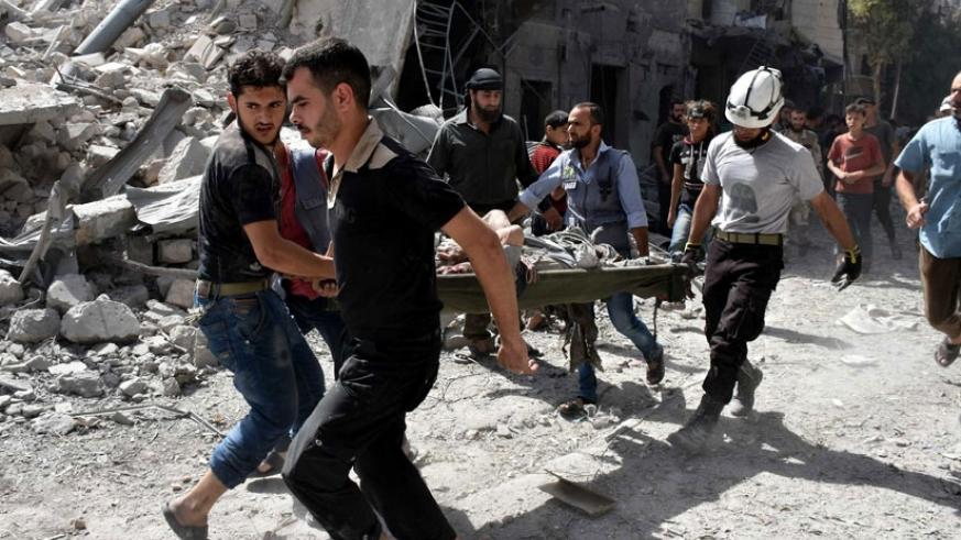 A wounded man is rescued after airstrikes in Aleppo, Syria on Wednesday. (Net photo)