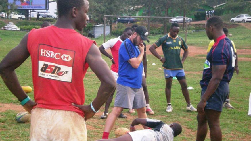 Silverbacks' coach David Haddock (blue) explains a rucking drill on Tuesday. The team left for Nairobi on Thursday. (Stephen Kalimba)