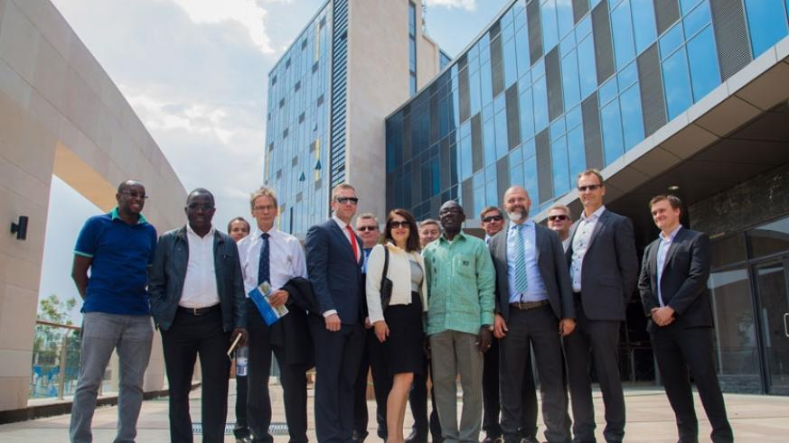 Investors and officials of the Kigali Heights Complex pose for a group photo after a guided tour of the building. The facility will house big retail brands and banking institutions....