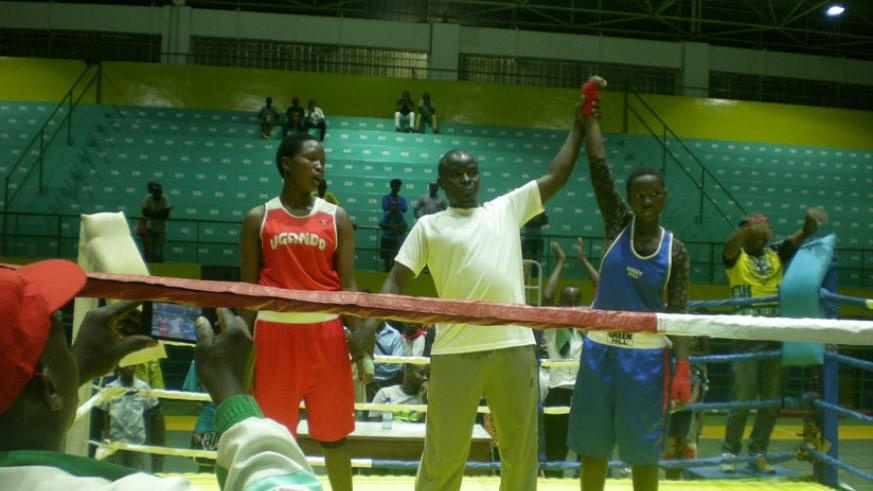The referee pronounces Cecile Umubyeyi the winner of her fight against Hanifah Nandujja in the only girls bout of the tournament. S. Kalimba