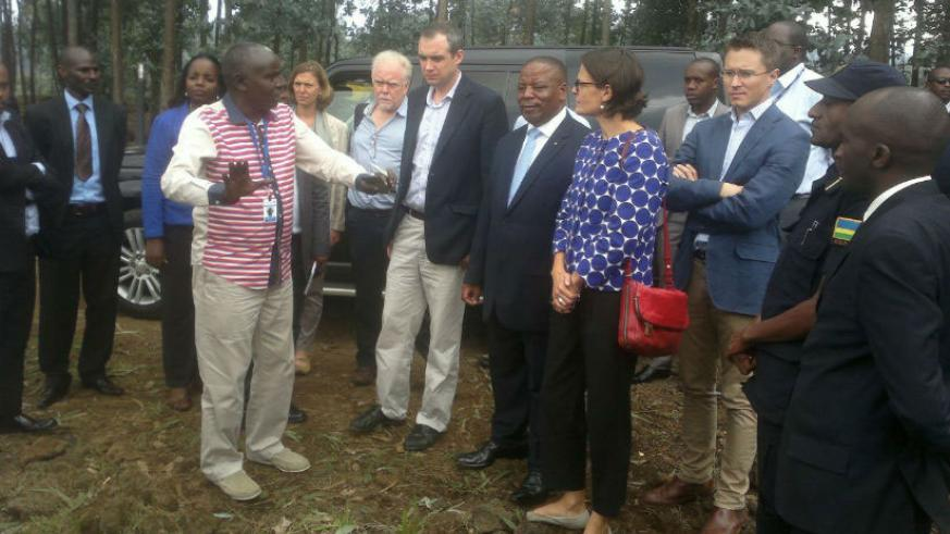 Minister Wharton (in black jacket), Northern Province Governor, Aime Bosenibamwe, DFID Country Head Laure Bonfils, and UK High Commissioner to Rwanda William Gelling, among other o....