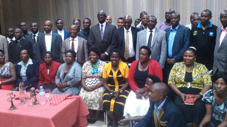 The delegation from Muntuyera High School - Kitunga poses for a group photo with Minister Busingye (5th left, standing) and Uganda's High Commissioner to Rwanda Amb. Kabonero (cent....