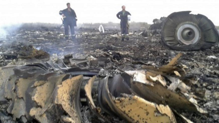 July 17, 2014 | Emergency officials work at the site of a Malaysia Airlines crash in the Donetsk region of eastern Ukraine. Photograph: Maxim Zmeyev/Reuters