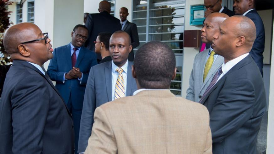 Musoni (L) shares a light moment with other officials after signing Imihigo for MININFRA yesterday. (T. Kisambira)