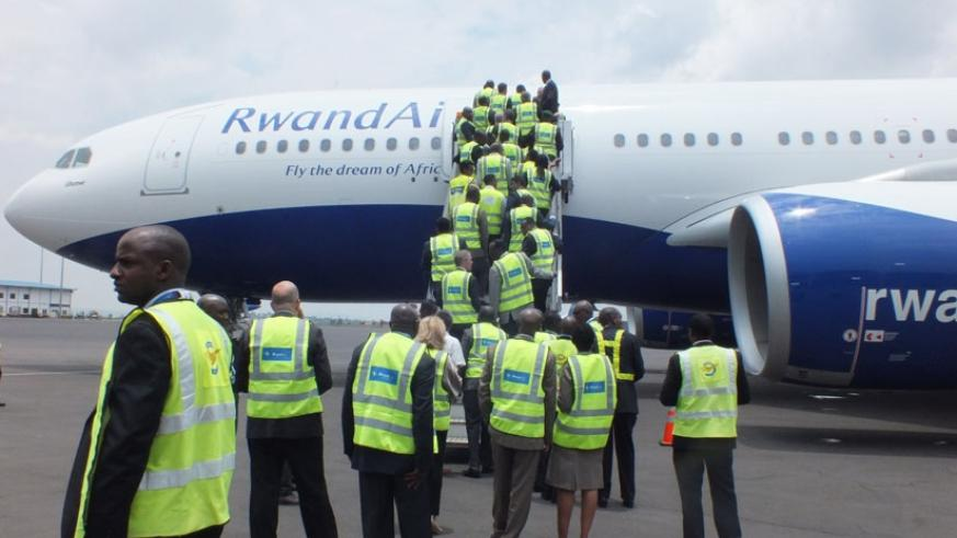 RwandAir staff and other public officials board Ubumwe for a tour yesterday. / Peterson Tumwebaze
