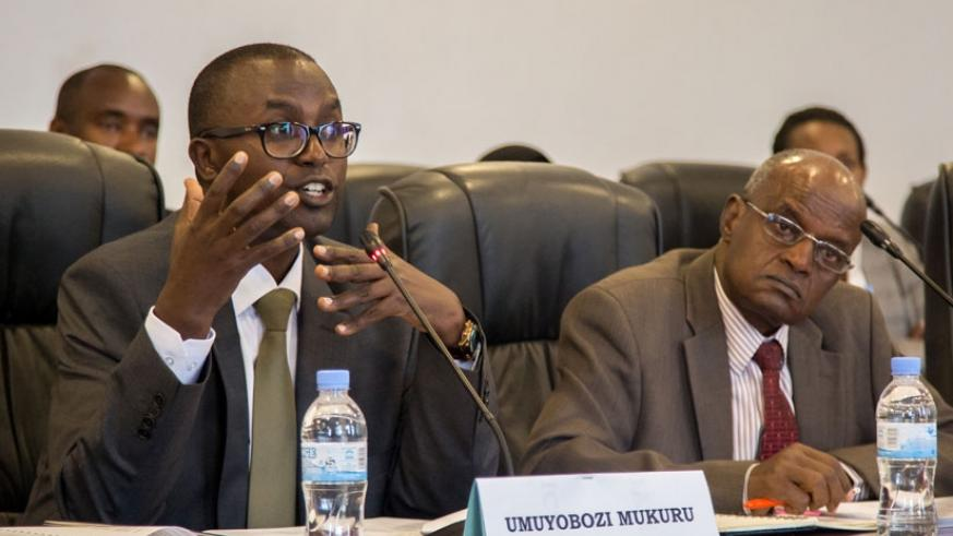 Dr Gatera (L) responds to queries from PAC at Parliament, yesterday, as Dr Gakwaya listens.  (Faustin Niyigena)