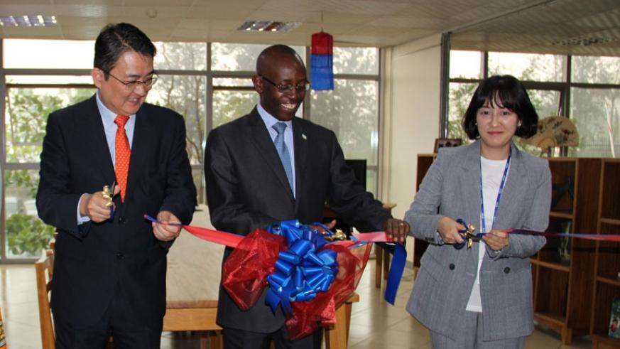 L-R: Amb.Park Yong-min, Dr Ntivuguruzwa and Choi je yun, Deputy country director of KOICA during the launch of the Korea Corner at the Kigali Public Library in Kacyiru on Tuesday. ....