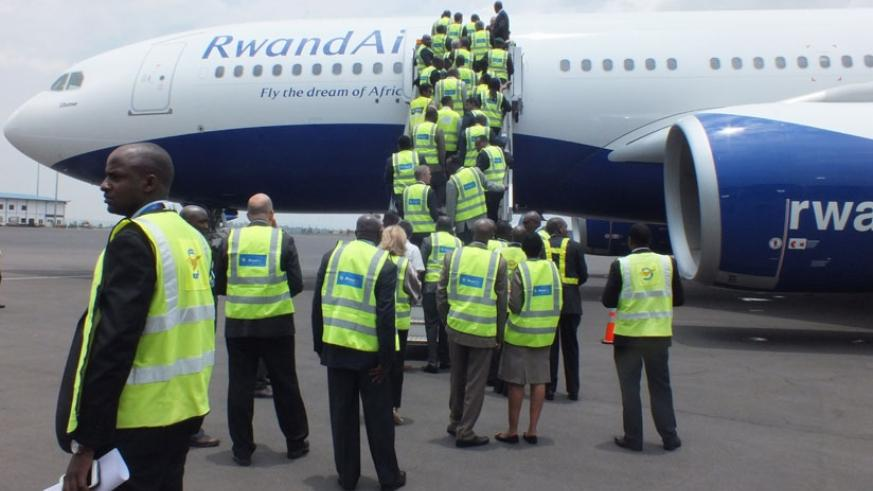 RwandAir staff and other public officials board Airbus A330-200 (named Ubumwe) for an interior tour on Wednesday. (Courtesy.)