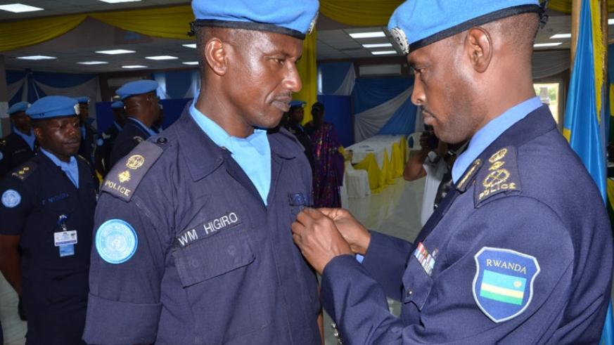 UNMISS Police Commissioner, Commissioner of Police (CP) Bruce Munyambo decorates Senior Supt. Willy Marcel Higiro during the ceremony on Wednesday. (Courtesy.)