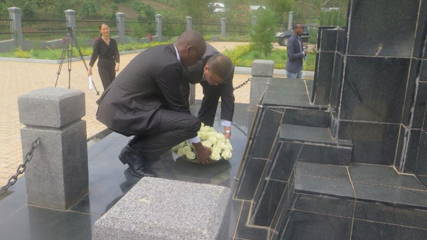 Chinese Amb. Pan Hejun and Theophile Rurangwa lay a wreath on the tombs of the Chinese martyrs in Rulindo District yesterday. / Hudson Kuteesa