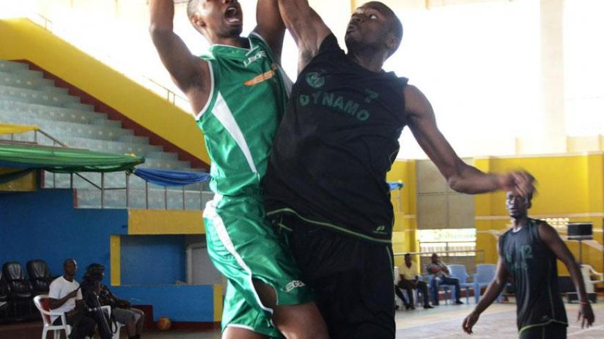 A Dynamo player tries to block Lionel Hakizimana from shooting during last year's Zone V Club Championships. / Sam Ngendahimana.