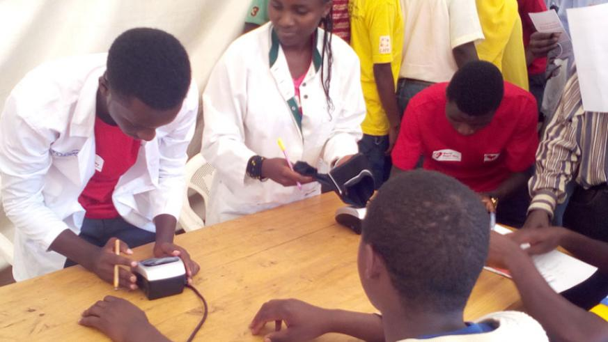 Medics screen  for residents for cardiovascular diseases during World Heart Day in Huye District last Friday. (Lydia Atieno)