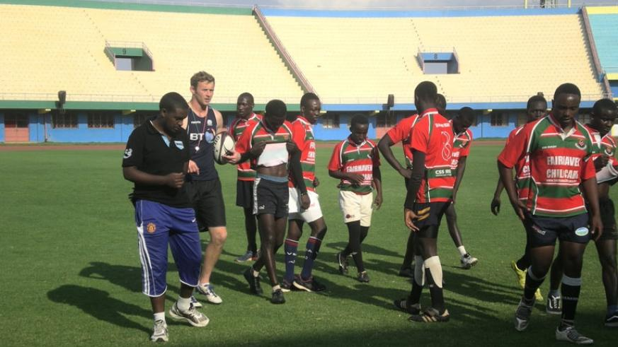 Scottish 7s captain Scott Wight (with ball) after a training session with rugby players and coaches on Suday at Amahoro National Stadium. (S.  Kalimba)