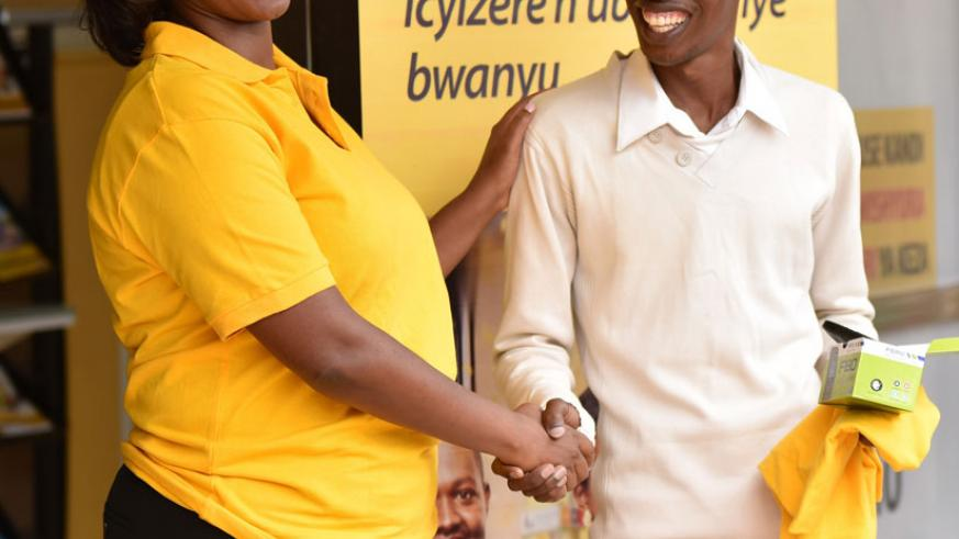 Makolo hands over prizes to a lucky winner during the launch. / Courtesy.