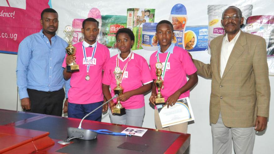 Winners of the Kinyarwanda competition pose with their trophies.  / Sharon Kantengwa