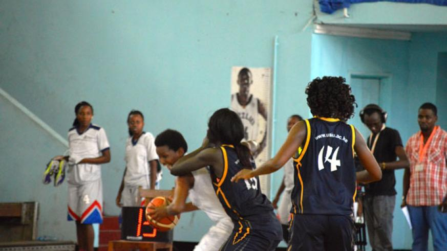 Ubumwe's shooting guard faces a tough challenge from USIU players as she tries to go for a shoot during yesterday's game. / Geoffrey Asiimwe