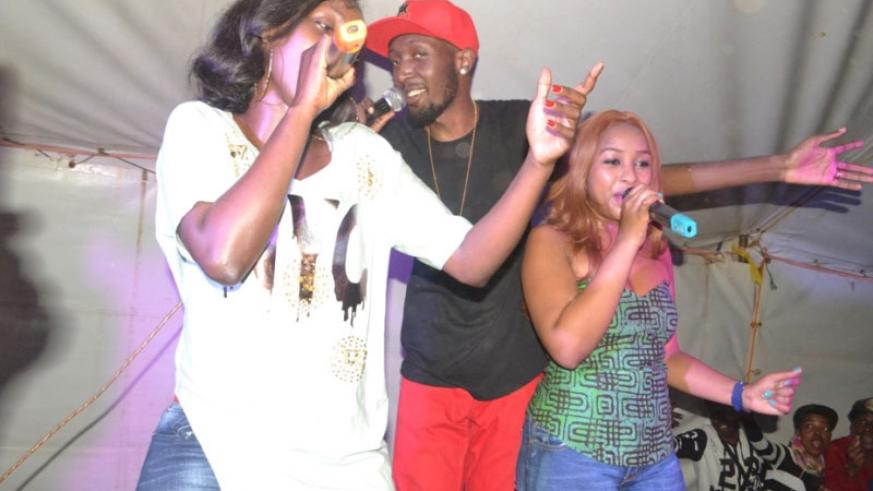Singers Charly and DJ Pius went to support their fellow artiste Nina (left, in a white t-shirt) as she performed in her hometown of Nyagatare District. (Richard Irakoze)