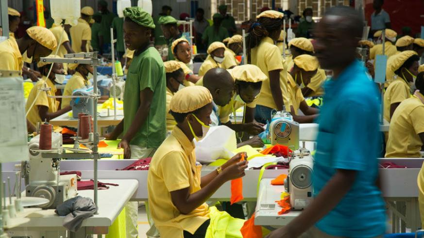 Workers at the C&H garments factory that recently opened shop in Kigali. A World Bank report has attributed Rwanda's economic stability to the growth in private sector. / File
