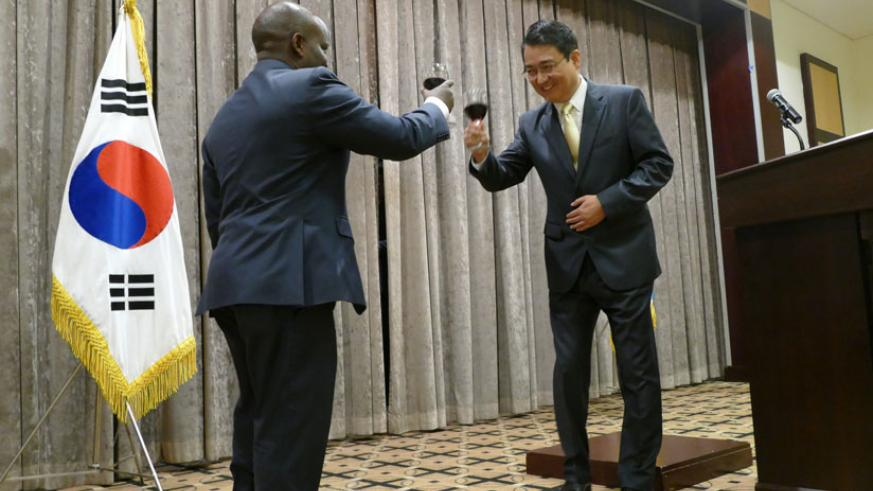 Amb. Park shares a toast with Nsengimana at the event to mark Korean Foundation Day in Kigali on Monday. / Courtesy.