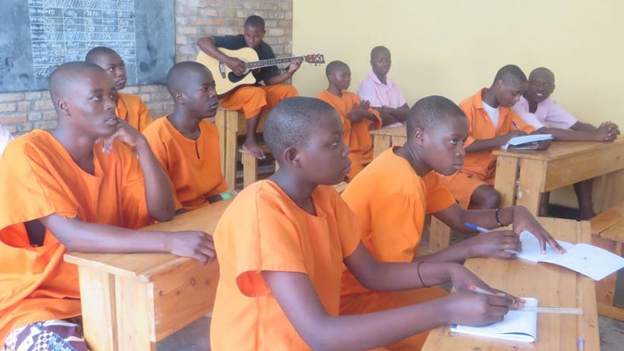 Juveniles attend a music lesson at the Nyagatare Rehabilitaion Centre. / Frederic Byumvuhore