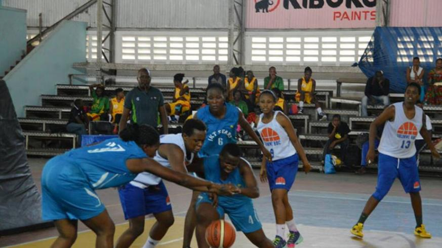 Ubumwe's Charlotte Umugwaneza in the middle scored the game high 22 points to guide her side to victory. / Geoffrey Asiimwe