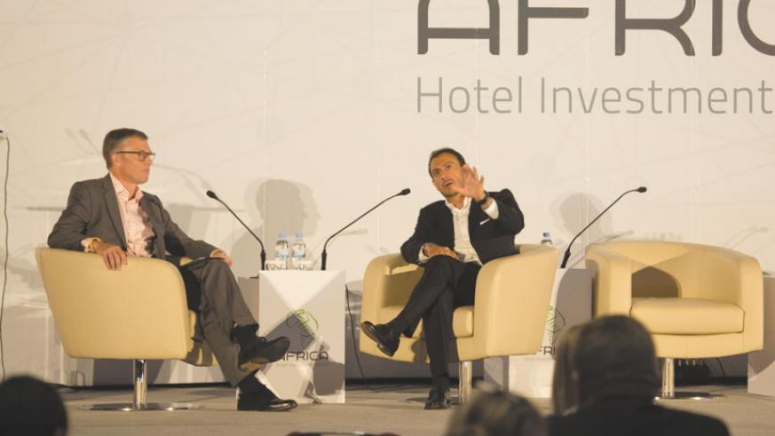 Jonathan Hubbard ((L), head of Investor Services EMEA Hotels and Hospitality, interviews Elie Younes during the meeting in Kigali. (Timothy Kisambira.)