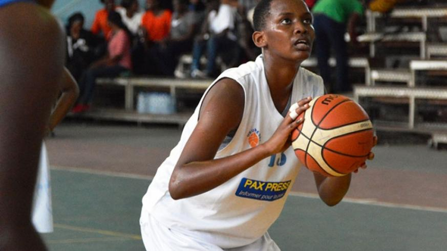 Ubumwe shooting guard Ines Nezerwa goes for a lay-up during their match with UCU on Thursday.  (G. Asiimwe.)