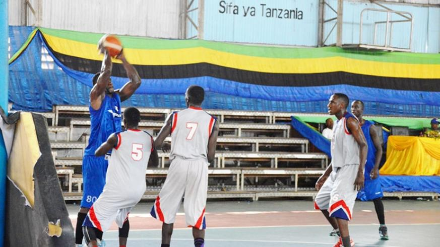 Espoir centre player Bievenue Ngandu takes a shot during their fifth-place playoff game  against UCU on Friday. / Geoffrey Asiimwe.