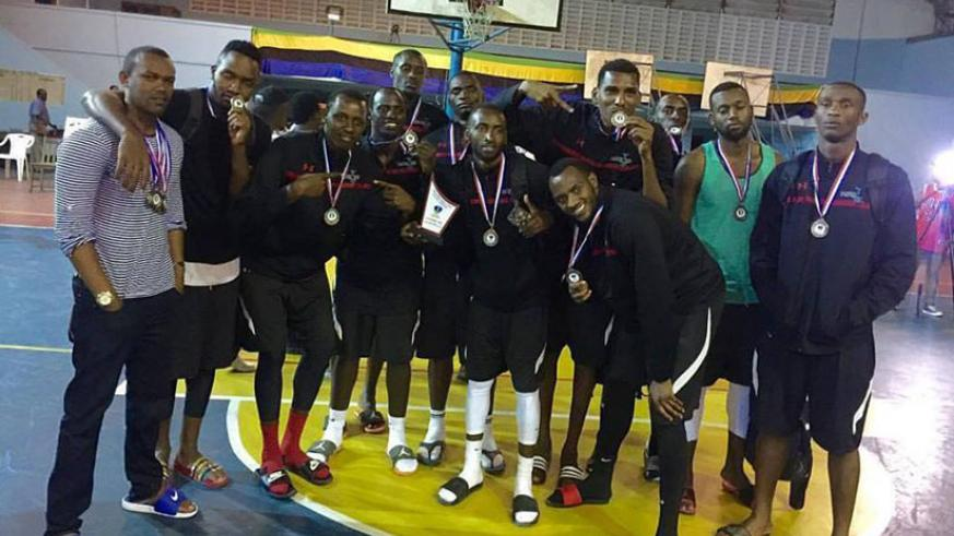 Ubumwe shooting guard Ines Nezerwa impressed but the team could only manage third-place finish while Patriots players pose with their bronze medals after defeating USIU of Kenya in....