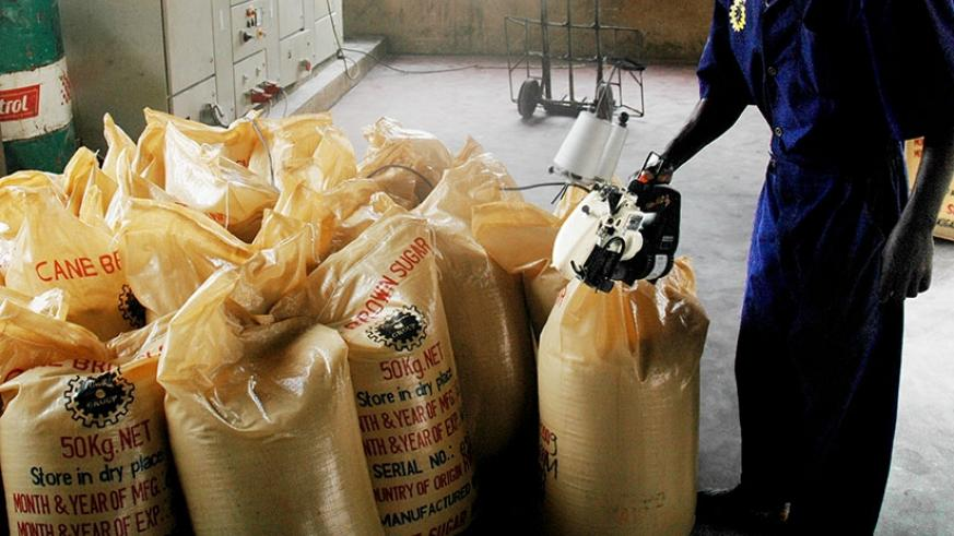 A man sealing sugar bags. The tax body is working with stakeholders in fight against fake VAT receipts. / File.