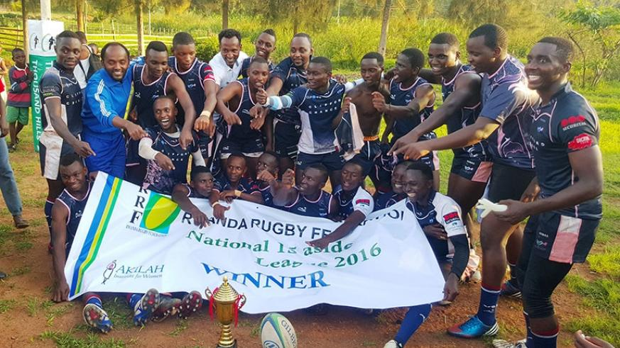 Thousand Hills RFC celebrate in a group photo after defeating Resilience to win the national championship. / A. Nadia Tasha