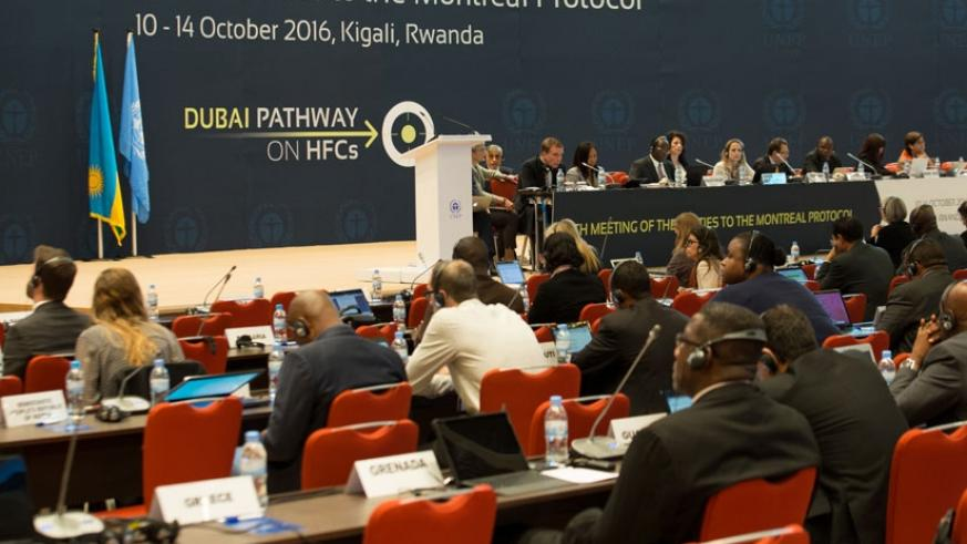 Participans follow proceedings during the Montreal Protocol meet yesterday. (T. Kisambira.)