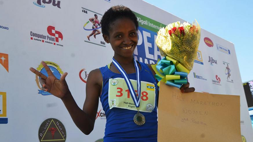 Salome Nyirarukundo celebrates her second position in Half Marathon on May 22, 2016. / Sam Ngendahimana