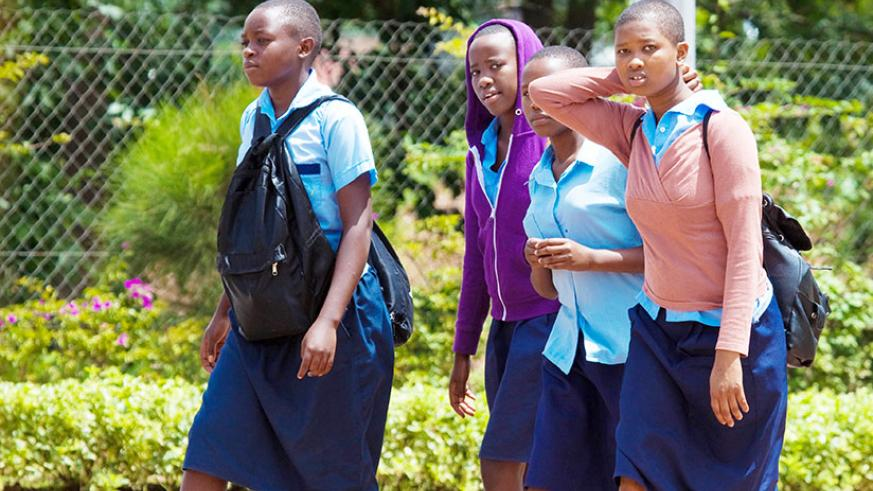 Girls are encouraged to stay in school. / Timothy Kisambira