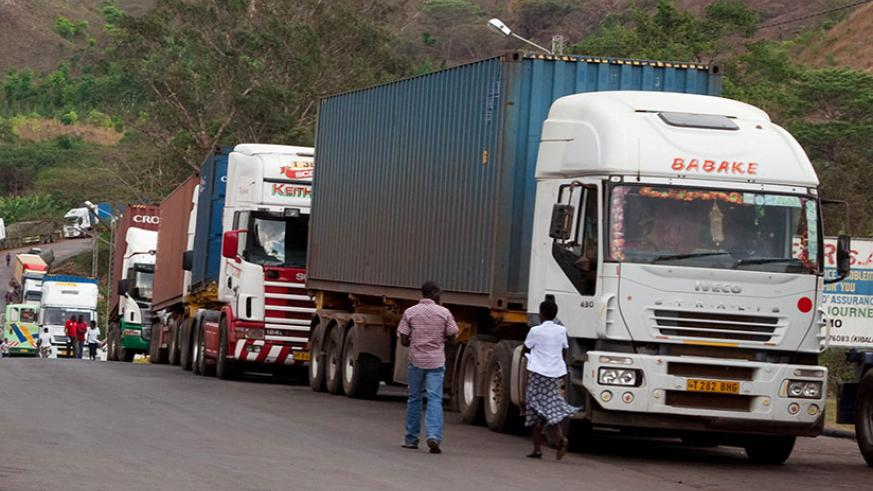 Cargo trucks enter Rwanda at Rusumo. EAC business leaders are calling for unlimited movement of goods and labour. / File