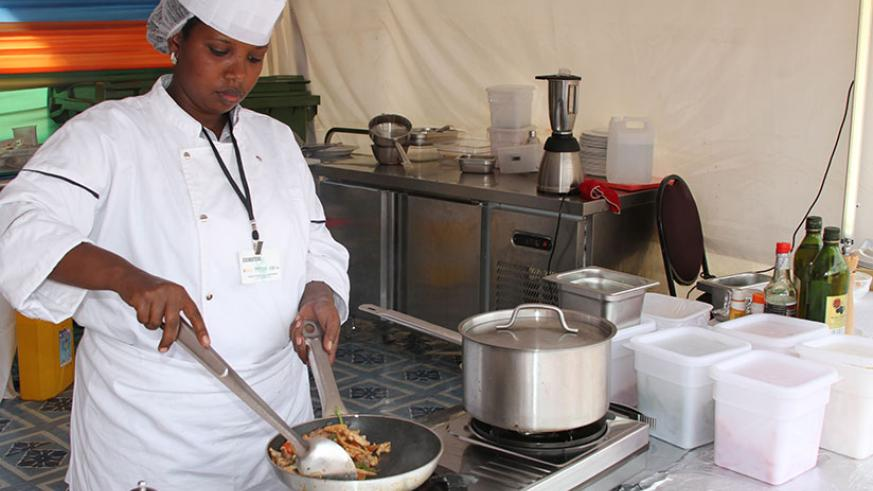 A cook prepares a meal at a hotel in Kigali. / File