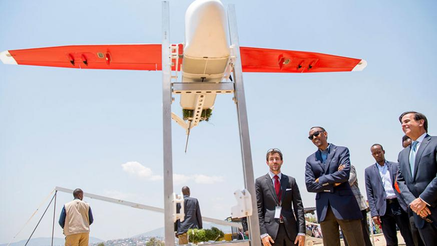 President Kagame with officials from Zipline Inc. at the launch of medical delivery drones in Muhanga District yesterday. Kagame said the launch of medical supplies delivery using ....