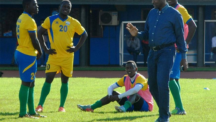 Vincent Nzamwita chats with Amavubi players during a past training camp at Amahoro National Stadium. The FERWAFA president is accused by rivals of not doing things the right way. File