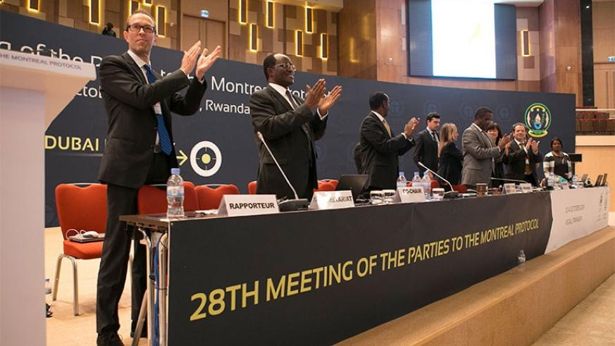 Delegates applaud the signing of the Kigali Amendment at the 28th Meeting of Parties to the Montreal  Protocol at Kigali Convention Centre on Saturday. Rwanda has set January 2017 ....