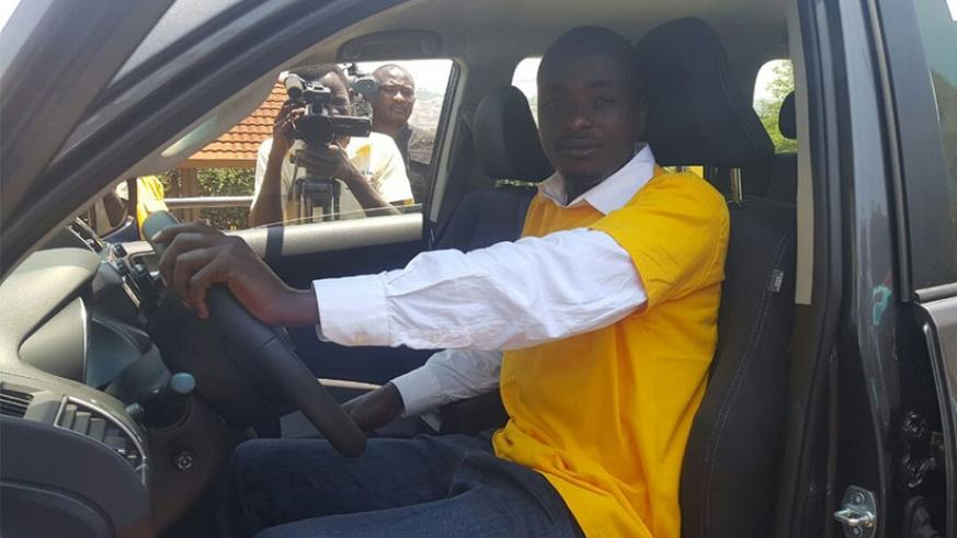 Shumbusho tries out the car at the telecom firm's head offices in Kigali. (Courtesy.)