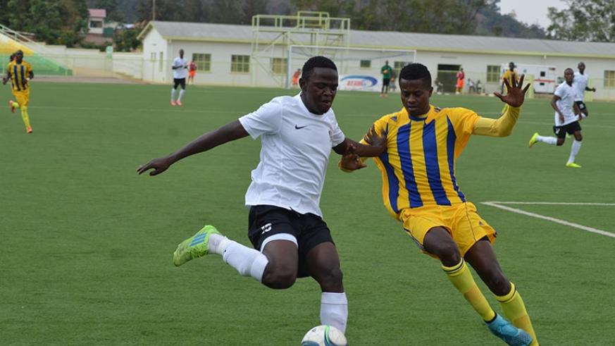 Muhadjiri Hakizimana, left, controls the ball under pressure from Amagaju defender on Sunday at Kigali Regional