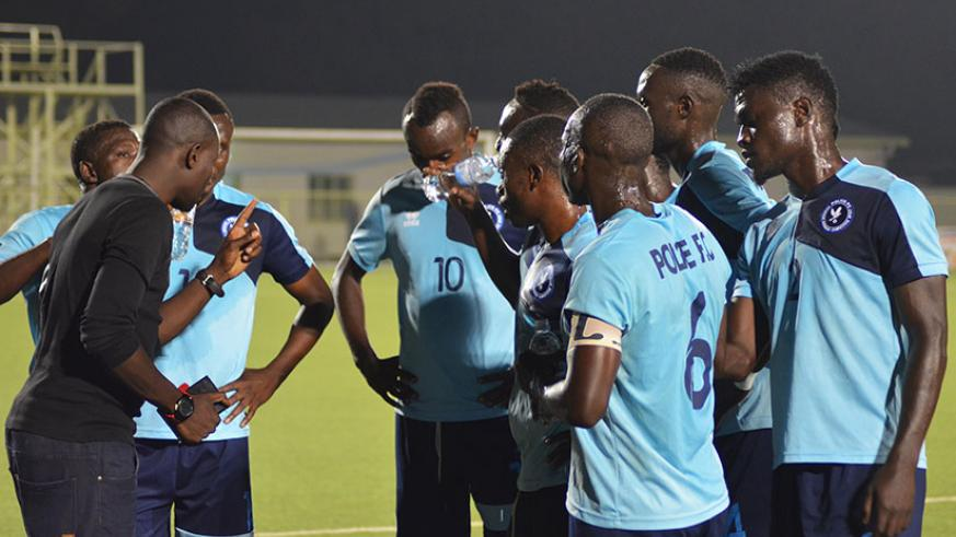 Police players listen to instructions from coach Seninga during the Rayon Sports game last week. Police will be keen to return to winning ways when they take on Bugesera on Saturda....