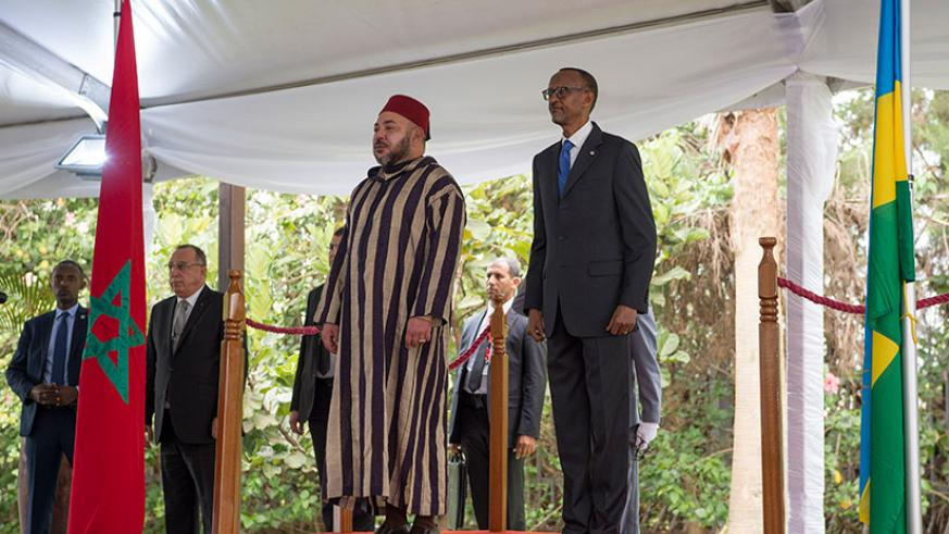 President Paul Kagame and Moroccan King Mohammed VI observe the national anthems of the two countries upon the visiting monarch's arrival at Village Urugwiro in Kacyiru yesterday. ....