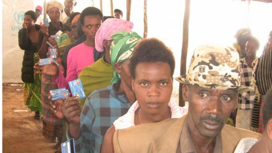 Congolese refugees in Nyabiheke queue to get their food allowance loaded onto their smartcards. (Kelly Rwamapera.)