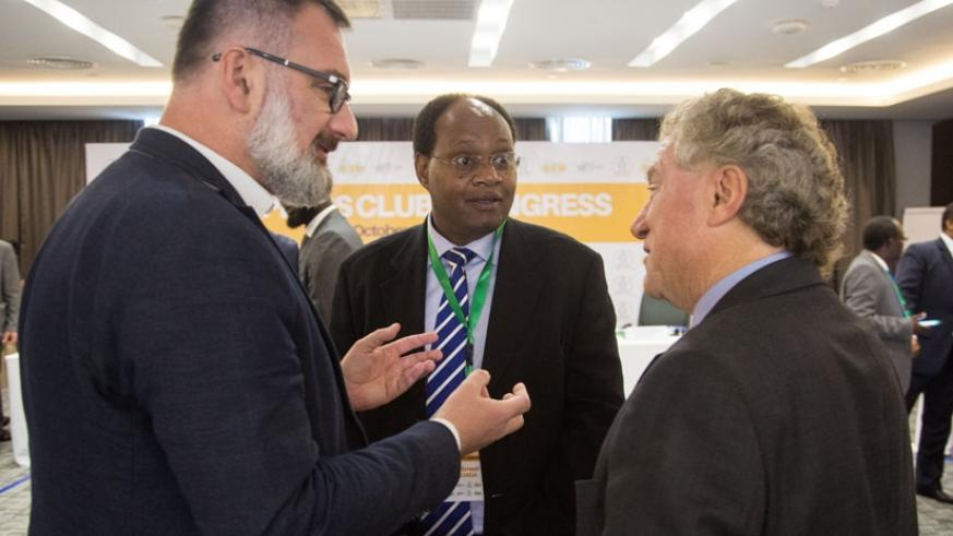 The Head of European Union Delegation to Rwanda, Amb. Michael Ryan (R), chats with Sagaga (C) and Wlodarczyk on the sidelines of ACP congress yesterday. (F. Niyigena.)