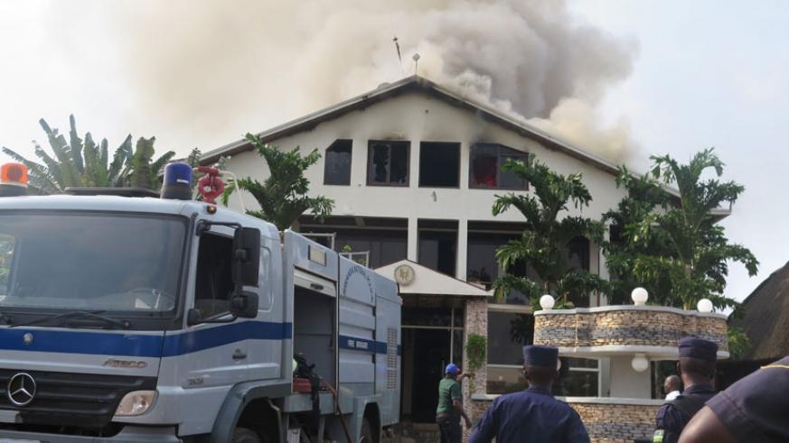 Fire fighters try to contain a fire at a complex in the past. The central bank has warned insurance companies against selling policies on credit and undercutting prices. (File photo)